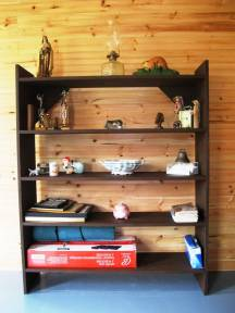 Bookshelf after staining with random items and no books.
